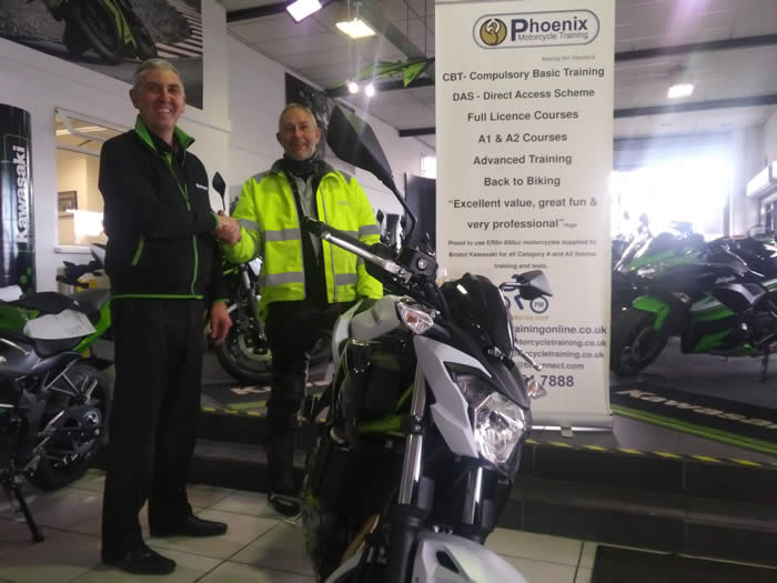 Mike receiving one of the Z650 KRTS bikes from Steve at Kawasaki